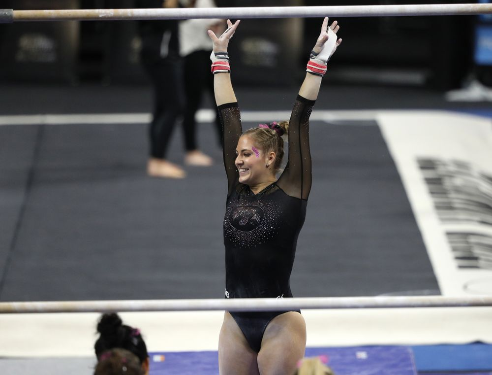 Iowa's Emma Hartzler competes on the bars during their meet against the Minnesota Golden Gophers Saturday, January 19, 2019 at Carver-Hawkeye Arena. (Brian Ray/hawkeyesports.com)