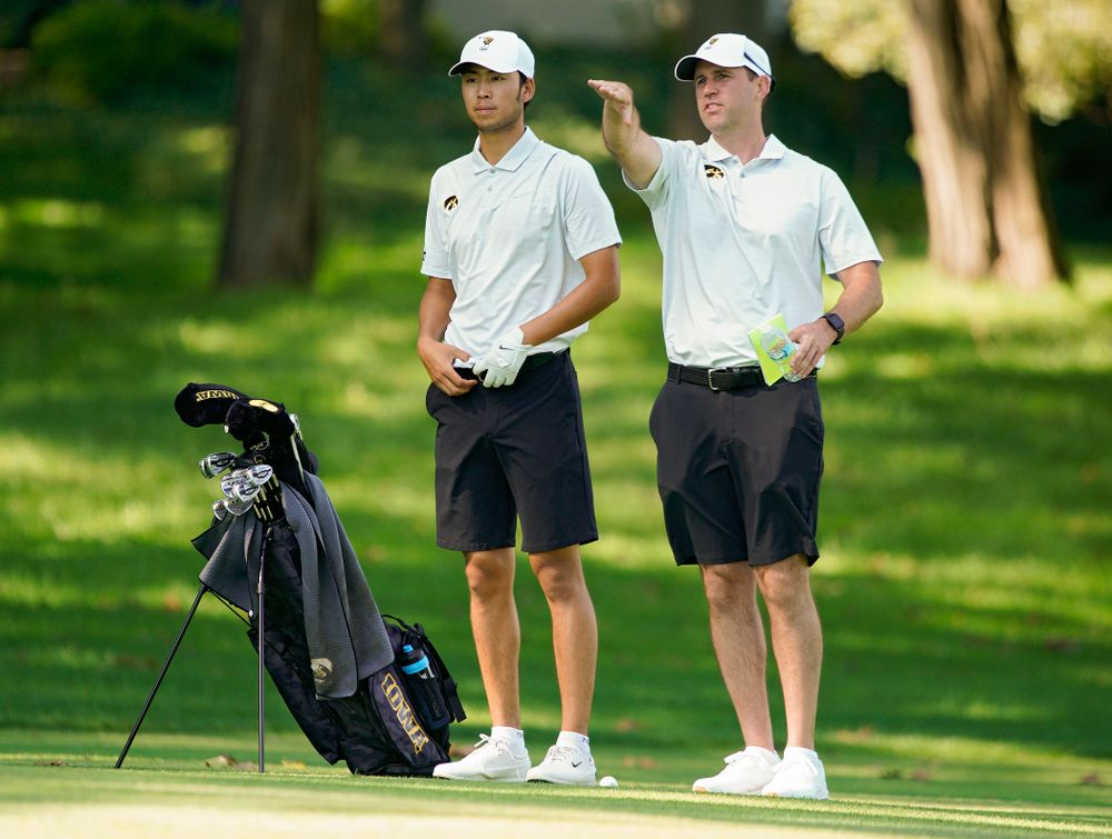 Iowa's Joe Kim (from left) talks with head coach Tyler Stith during the second day of the Golfweek Conference Challenge at the Cedar Rapids Country Club in Cedar Rapids on Monday, Sep 16, 2019. (Stephen Mally/hawkeyesports.com)