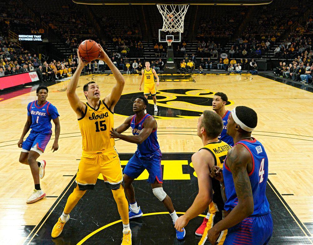 Iowa Hawkeyes forward Ryan Kriener (15) scores a basket inside during the first half of their game at Carver-Hawkeye Arena in Iowa City on Monday, Nov 11, 2019. (Stephen Mally/hawkeyesports.com)