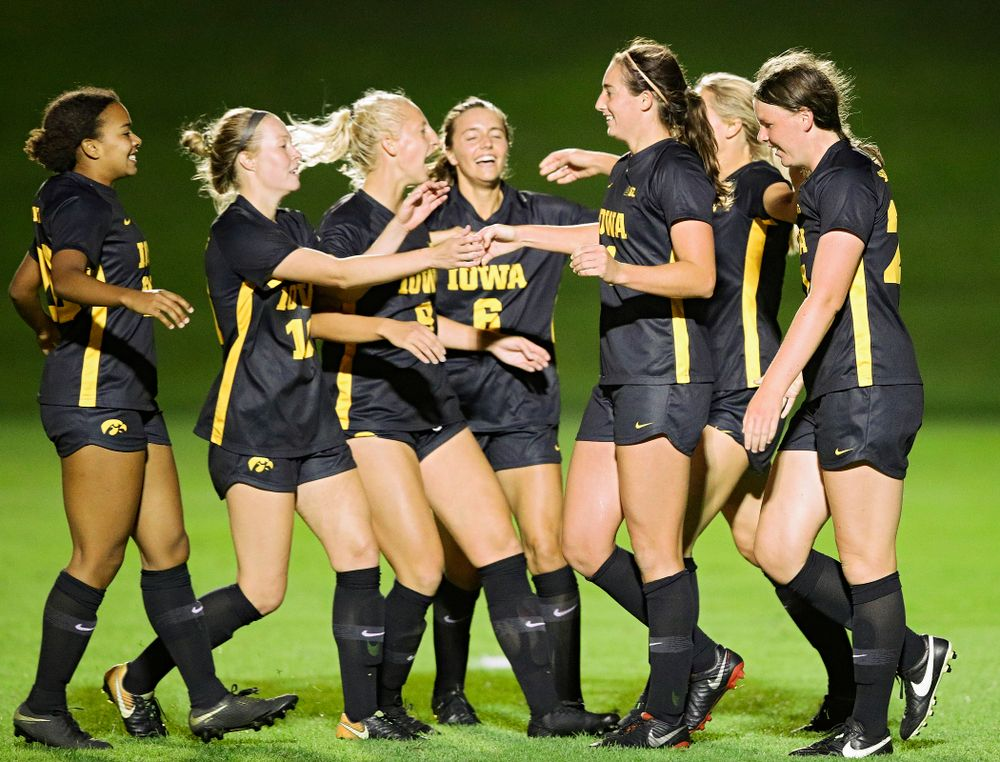 Iowa forward Kaleigh Haus (4) celebrates her goal with her teammates during the second half of their match against Illinois at the Iowa Soccer Complex in Iowa City on Thursday, Sep 26, 2019. (Stephen Mally/hawkeyesports.com)