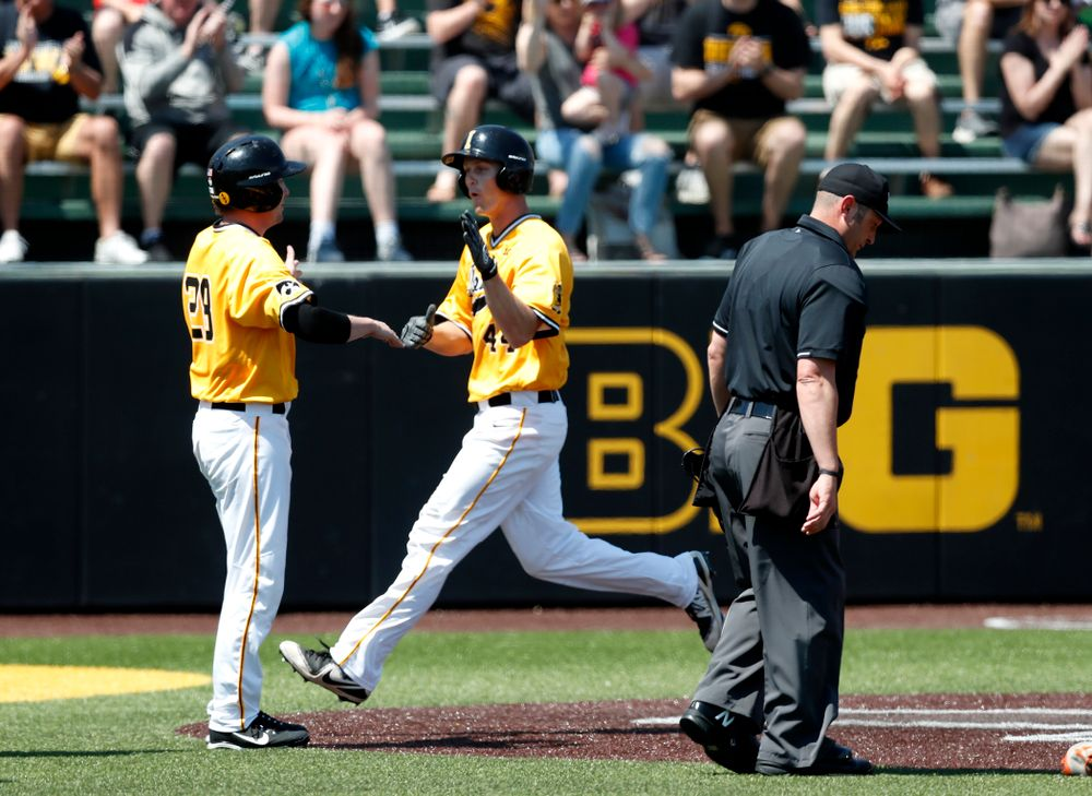 Iowa Hawkeyes outfielder Robert Neustrom (44) scores against the Oklahoma State Cowboys Sunday, May 6, 2018 at Duane Banks Field. (Brian Ray/hawkeyesports.com)