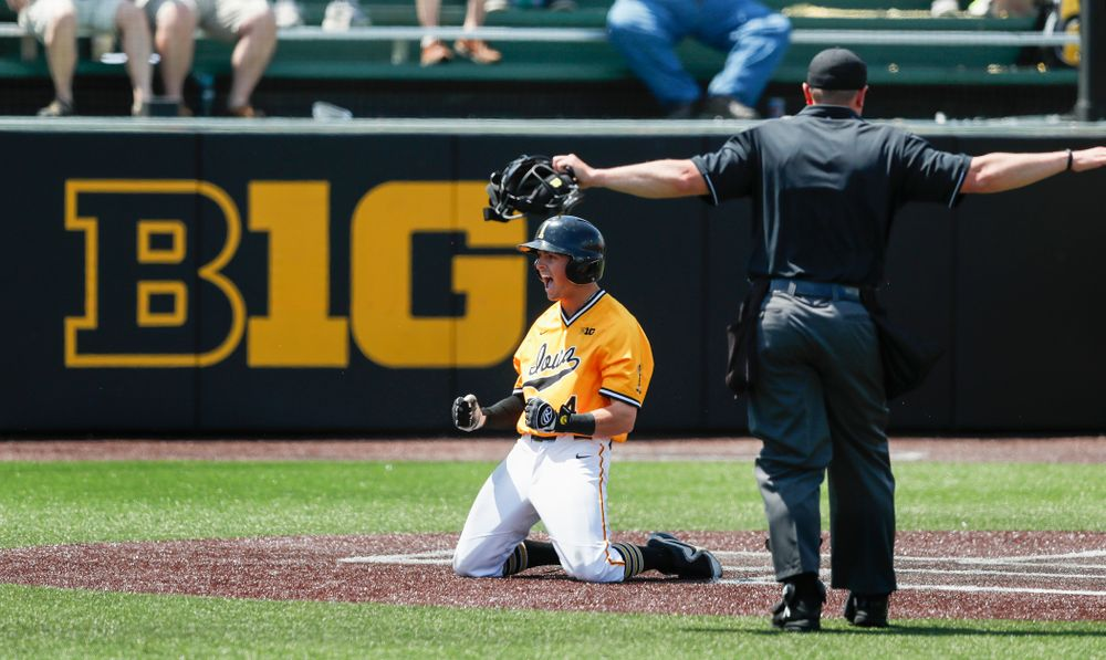 Iowa Hawkeyes infielder Mitchell Boe (4) celebrates and inside the park home run against the Oklahoma State Cowboys Sunday, May 6, 2018 at Duane Banks Field. (Brian Ray/hawkeyesports.com)