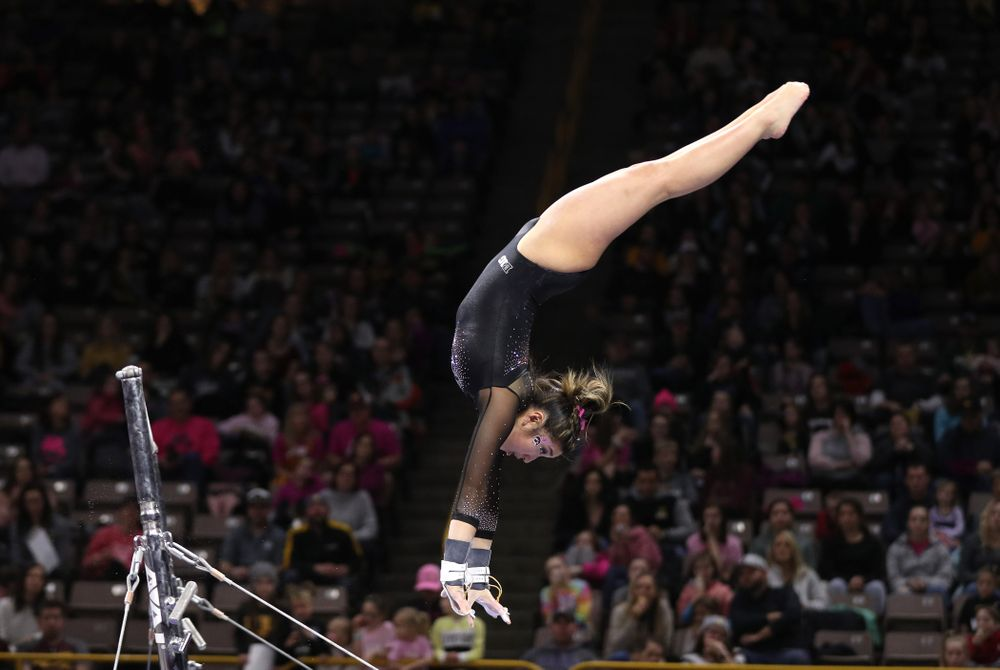 Iowa's Nicole Chow competes on the bars during their meet against the Minnesota Golden Gophers Saturday, January 19, 2019 at Carver-Hawkeye Arena. (Brian Ray/hawkeyesports.com)