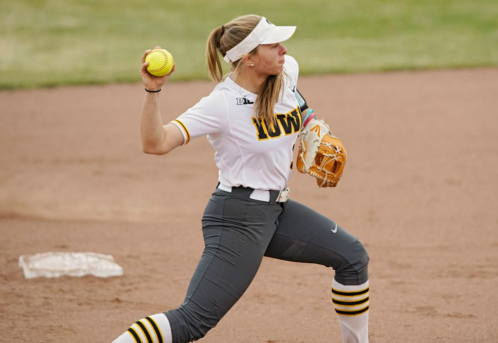Iowa Hawkeyes Sydney Owens (5) throws to first base for an out during the sixth inning of their Big Ten Conference softball game at Pearl Field in Iowa City on Friday, Mar. 29, 2019. (Stephen Mally/hawkeyesports.com)
