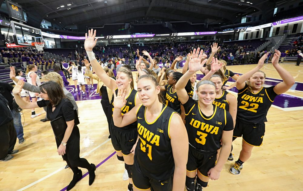 The Hawkeyes wave to their fans after winning their game at Welsh-Ryan Arena in Evanston, Ill. on Sunday, January 5, 2020. (Stephen Mally/hawkeyesports.com)
