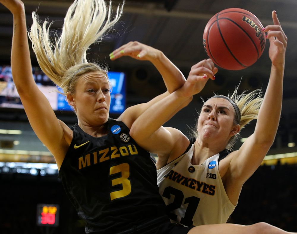 Iowa Hawkeyes forward Hannah Stewart (21) tries to pull in a rebound around Missouri Tigers guard Sophie Cunningham (3) during the first quarter of their second round game in the 2019 NCAA Women's Basketball Tournament at Carver Hawkeye Arena in Iowa City on Sunday, Mar. 24, 2019. (Stephen Mally for hawkeyesports.com)