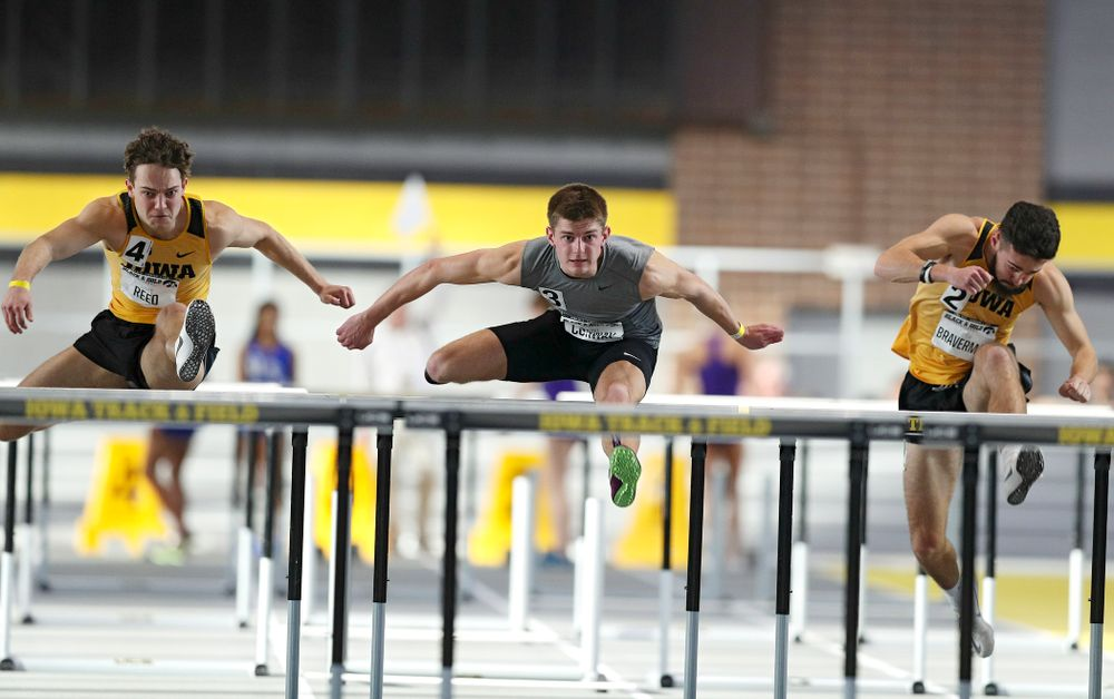 Iowa's Gratt Reed (from left), Grant Conway, and Josh Braverman run the men's 60 meter hurdles event at the Black and Gold Invite at the Recreation Building in Iowa City on Saturday, February 1, 2020. (Stephen Mally/hawkeyesports.com)