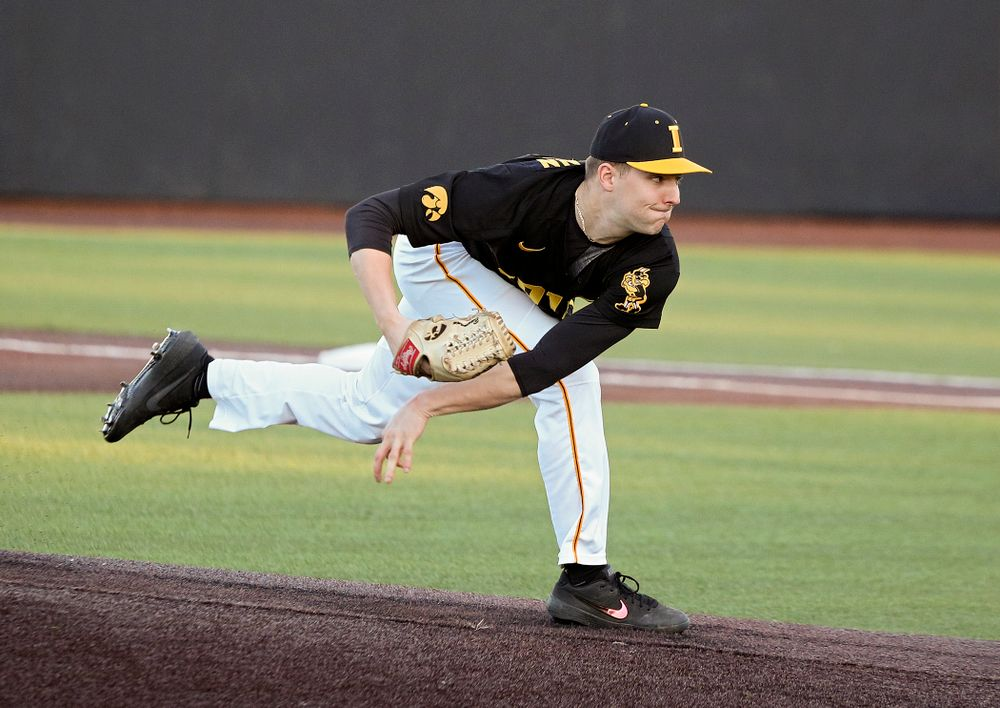Iowa pitcher Cam Baumann (35) delivers to the plate during the fourth inning of their game at Duane Banks Field in Iowa City on Tuesday, March 3, 2020. (Stephen Mally/hawkeyesports.com)