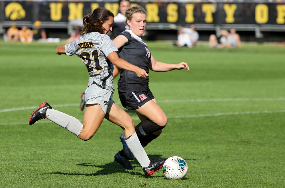 Iowa forward Emma Tokuyama (21) scores a goal during the second half of their match at the Iowa Soccer Complex in Iowa City on Sunday, Sep 1, 2019. (Stephen Mally/hawkeyesports.com)