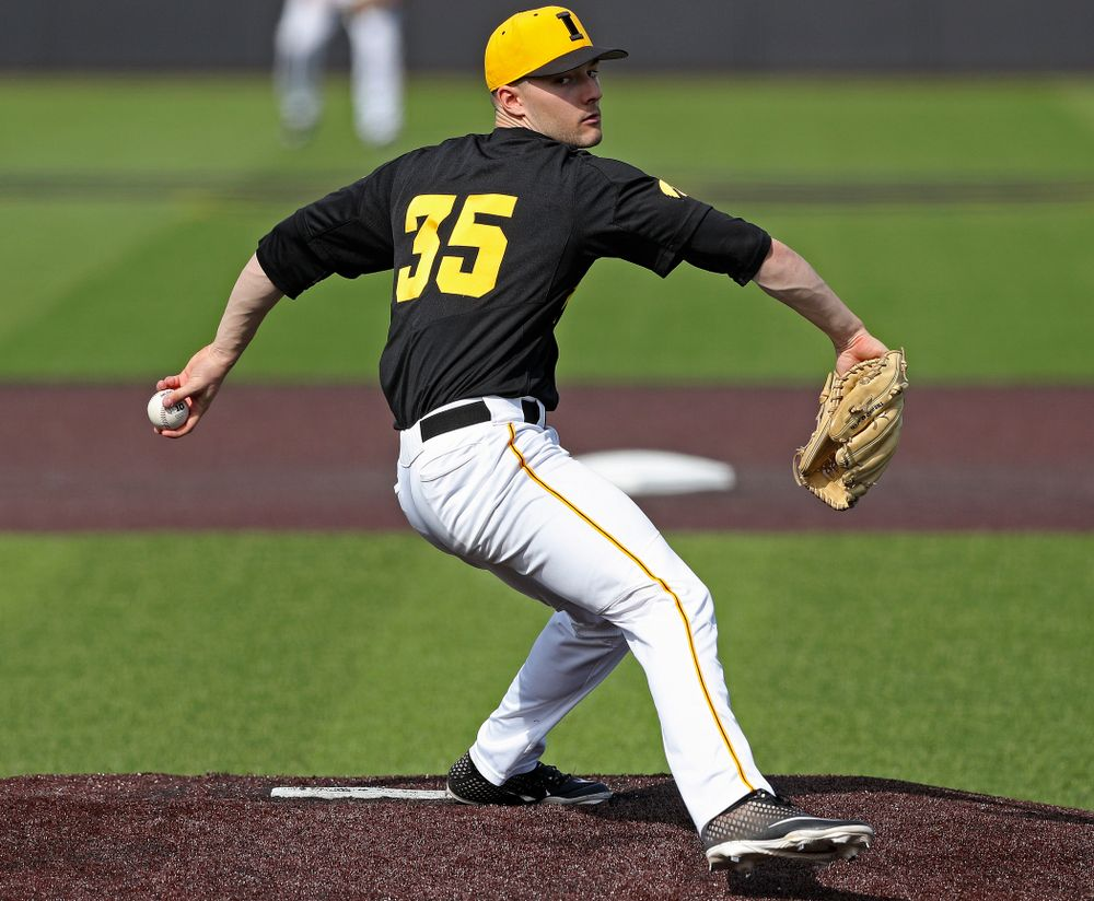 Iowa Hawkeyes pitcher Cam Baumann (35) delivers to the plate during the sixth inning of their game against Rutgers at Duane Banks Field in Iowa City on Saturday, Apr. 6, 2019. (Stephen Mally/hawkeyesports.com)