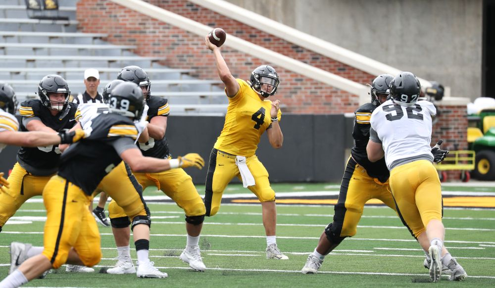 QB Nate Stanley (4) rips a pass downfield
