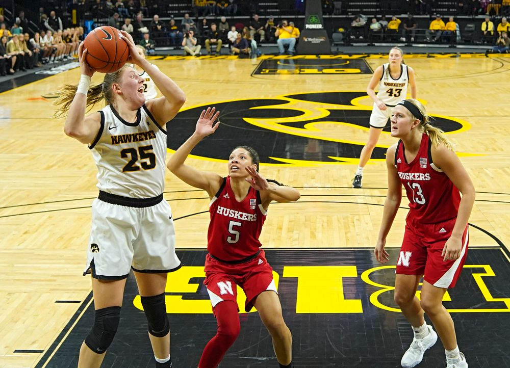 Iowa Hawkeyes forward Monika Czinano (25) pulls down a rebound during the second quarter of the game at Carver-Hawkeye Arena in Iowa City on Thursday, February 6, 2020. (Stephen Mally/hawkeyesports.com)