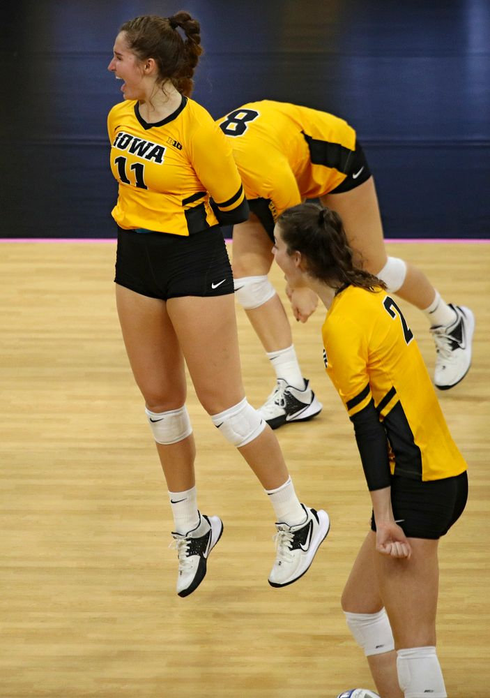 Iowa's Blythe Rients (11) celebrates her block with Kyndra Hansen (8) and Courtney Buzzerio (2) during their match at Carver-Hawkeye Arena in Iowa City on Sunday, Oct 20, 2019. (Stephen Mally/hawkeyesports.com)