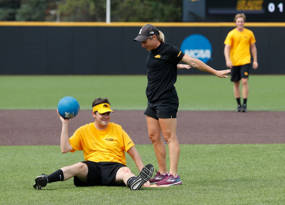 Head Women's Golf Coach Megan Menzel and Asst. Director Compliance Henry Archuleta during the Iowa Student Athlete Kickoff Kickball game  Sunday, August 19, 2018 at Duane Banks Field. (Brian Ray/hawkeyesports.com)