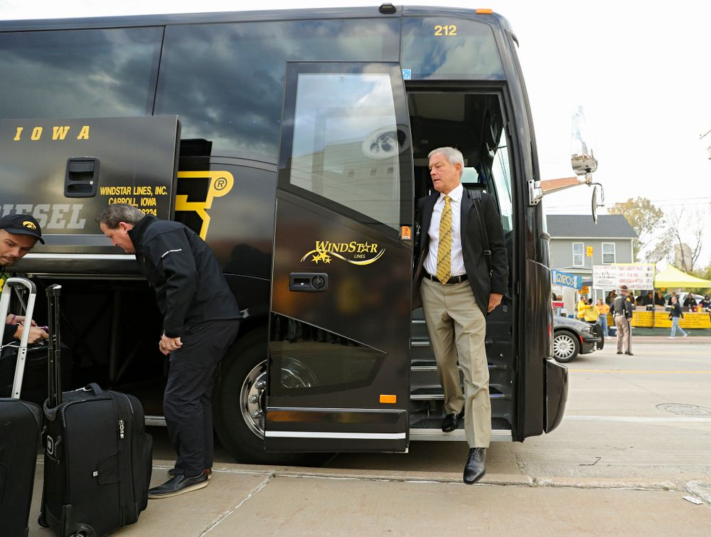 Iowa Hawkeyes head coach Kirk Ferentz steps off the bus as he arrives with his team before their game at Kinnick Stadium in Iowa City on Saturday, Oct 19, 2019. (Stephen Mally/hawkeyesports.com)