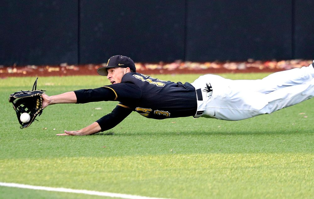 Iowa's Brayden Frazier (13) dives for a ball during the sixth inning of the first game of the Black and Gold Fall World Series at Duane Banks Field in Iowa City on Tuesday, Oct 15, 2019. (Stephen Mally/hawkeyesports.com)