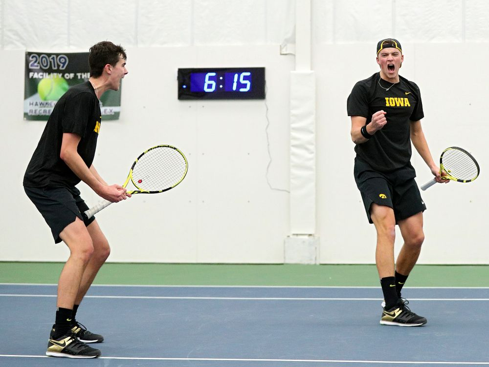 Iowa's Matt Clegg (from left) and Joe Tyler celebrate a point during their doubles match at the Hawkeye Tennis and Recreation Complex in Iowa City on Friday, February 14, 2020. (Stephen Mally/hawkeyesports.com)