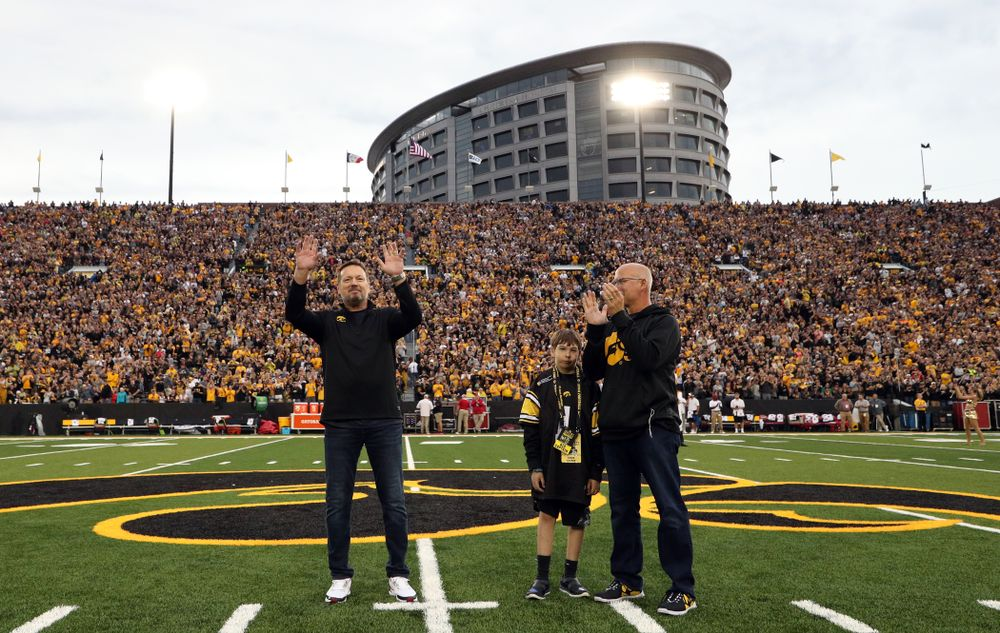 Honorary captain Bob Stoops with Kid Captain Aiden Kasper before the Iowa Hawkeyes game against the Miami RedHawks Saturday, August 31, 2019 at Kinnick Stadium in Iowa City. (Brian Ray/hawkeyesports.com)