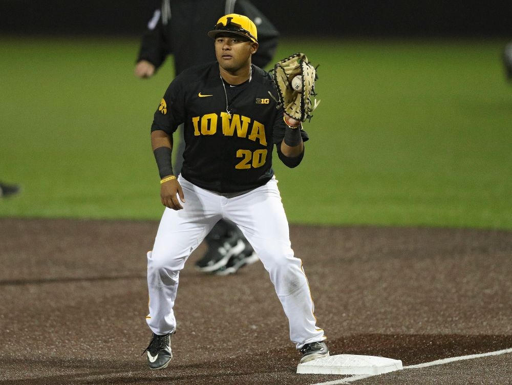 Iowa Hawkeyes first baseman Izaya Fullard (20) pulls in a throw for an out during the seventh inning of their game against Western Illinois at Duane Banks Field in Iowa City on Wednesday, May. 1, 2019. (Stephen Mally/hawkeyesports.com)
