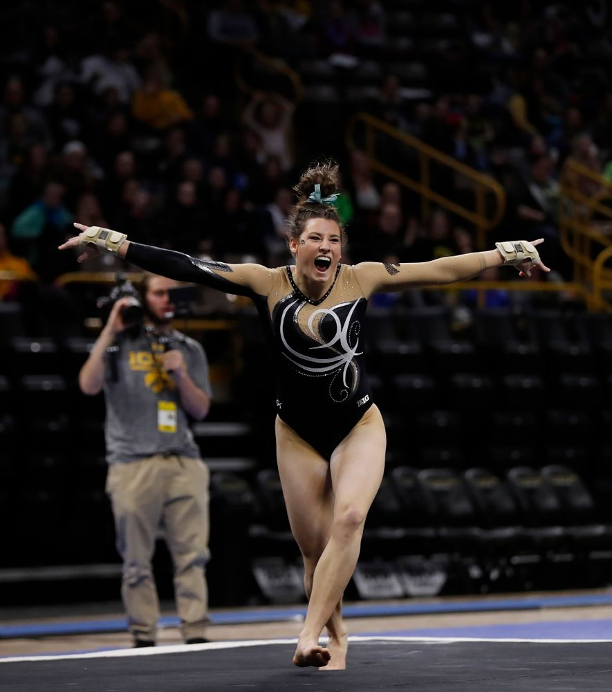 Iowa's Lanie Snyder competes on the floor against the Nebraska Cornhuskers