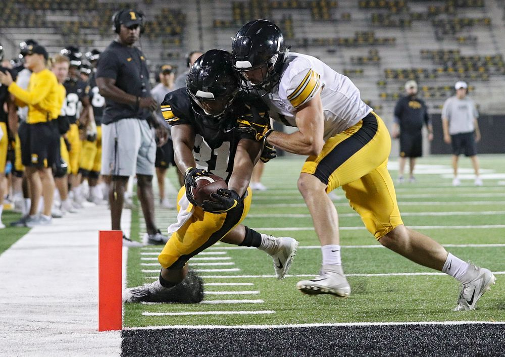 Iowa Hawkeyes running back Ivory Kelly-Martin (21) dives for the pylon as he is hit by defensive back Wes Dvorak (1) during Fall Camp Practice No. 12 at Kinnick Stadium in Iowa City on Thursday, Aug 15, 2019. (Stephen Mally/hawkeyesports.com)