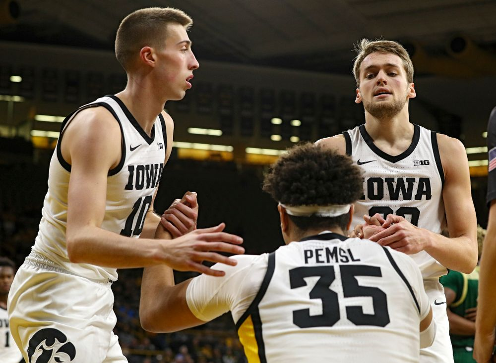 Iowa Hawkeyes guard Joe Wieskamp (10) and forward Riley Till (20) help up forward Cordell Pemsl (35) after he was fouled during the second half of their game at Carver-Hawkeye Arena in Iowa City on Sunday, Nov 24, 2019. (Stephen Mally/hawkeyesports.com)