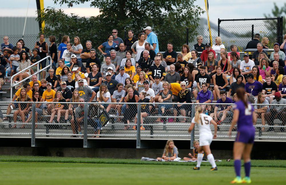 Fans watch as the Iowa Hawkeyes take on UNI