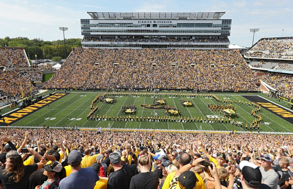"""People look on as the Pat Green performs """"Wave on Wave"""" during the second quarter of their Big Ten Conference football game at Kinnick Stadium in Iowa City on Saturday, Sep 7, 2019. (Stephen Mally/hawkeyesports.com)"""