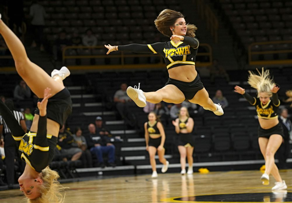 The Iowa Dance Team makes their way down the court during the fourth quarter of their game against Winona State at Carver-Hawkeye Arena in Iowa City on Sunday, Nov 3, 2019. (Stephen Mally/hawkeyesports.com)