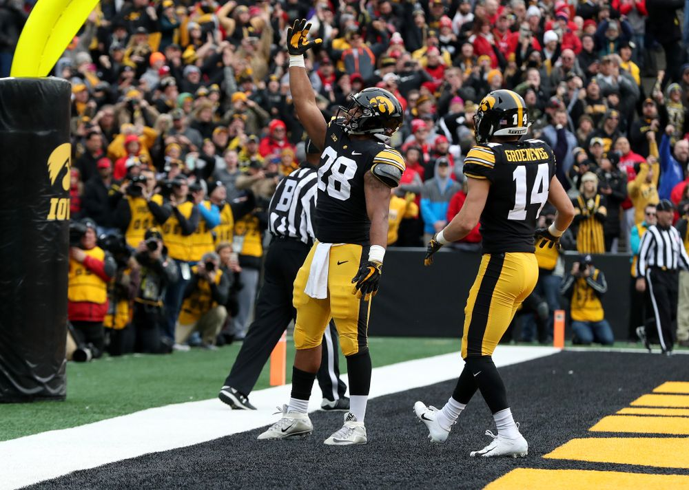 Iowa Hawkeyes running back Toren Young (28) blows a kiss to the fans after scoring against the Nebraska Cornhuskers Friday, November 23, 2018 at Kinnick Stadium. (Brian Ray/hawkeyesports.com)