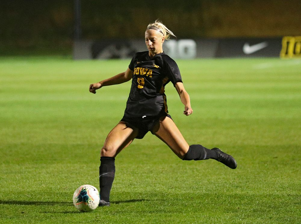 Iowa defender Samantha Cary (9) lines up a shot during the first half of their match against Illinois at the Iowa Soccer Complex in Iowa City on Thursday, Sep 26, 2019. (Stephen Mally/hawkeyesports.com)