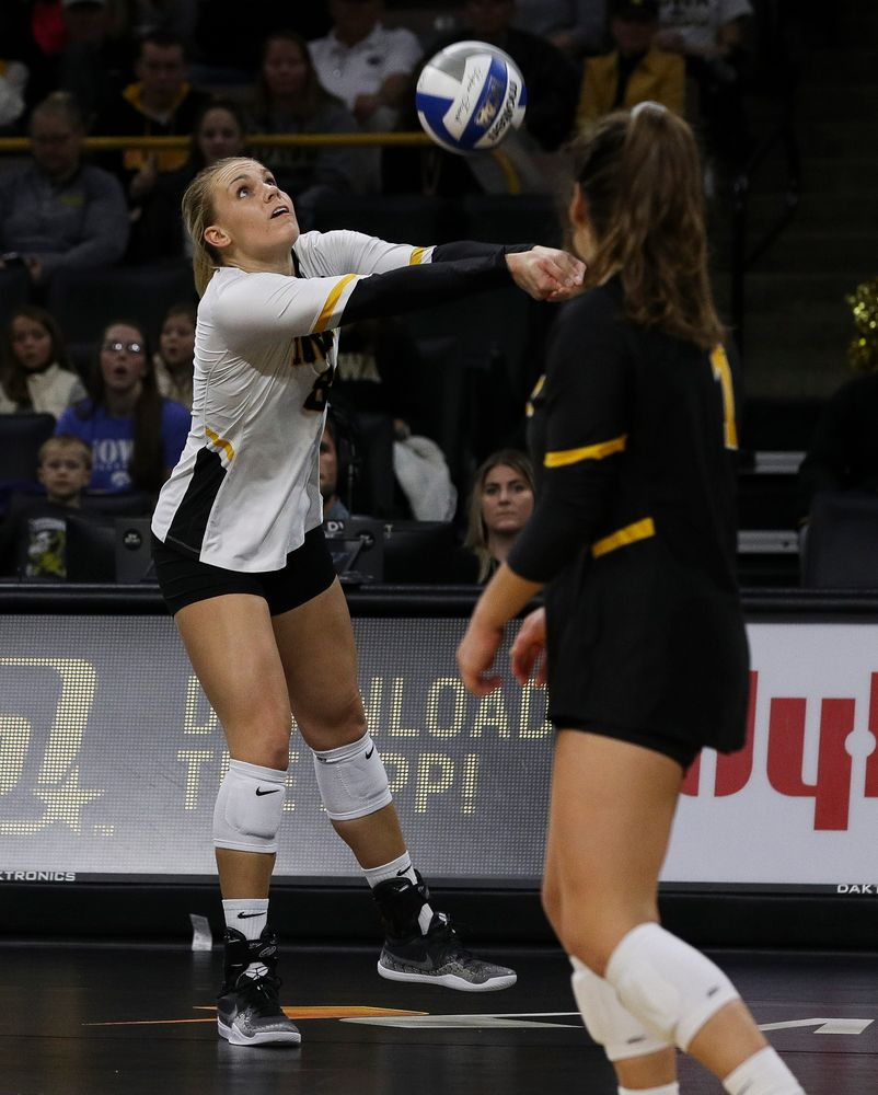 Iowa Hawkeyes right side hitter Reghan Coyle (8) bumps the ball during a match against Rutgers at Carver-Hawkeye Arena on November 2, 2018. (Tork Mason/hawkeyesports.com)