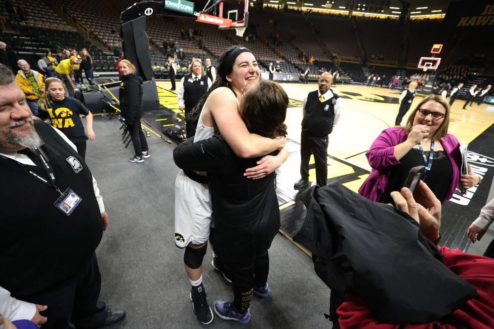 Iowa Hawkeyes forward Megan Gustafson (10) hugs her mother Eva following their game against the Illinois Fighting Illini Thursday, February 14, 2019 at Carver-Hawkeye Arena. (Brian Ray/hawkeyesports.com)