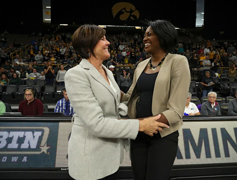 Michigan State head coach Cathy George (from left) and Iowa head coach Vicki Brown talk before the start of their volleyball match at Carver-Hawkeye Arena in Iowa City on Sunday, Oct 13, 2019. (Stephen Mally/hawkeyesports.com)