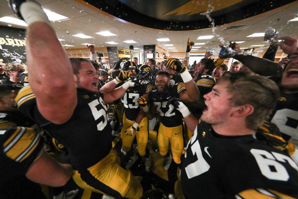 The Iowa Hawkeyes celebrate in the locker room following their game against the Nebraska Cornhuskers Friday, November 23, 2018 at Kinnick Stadium. (Brian Ray/hawkeyesports.com)
