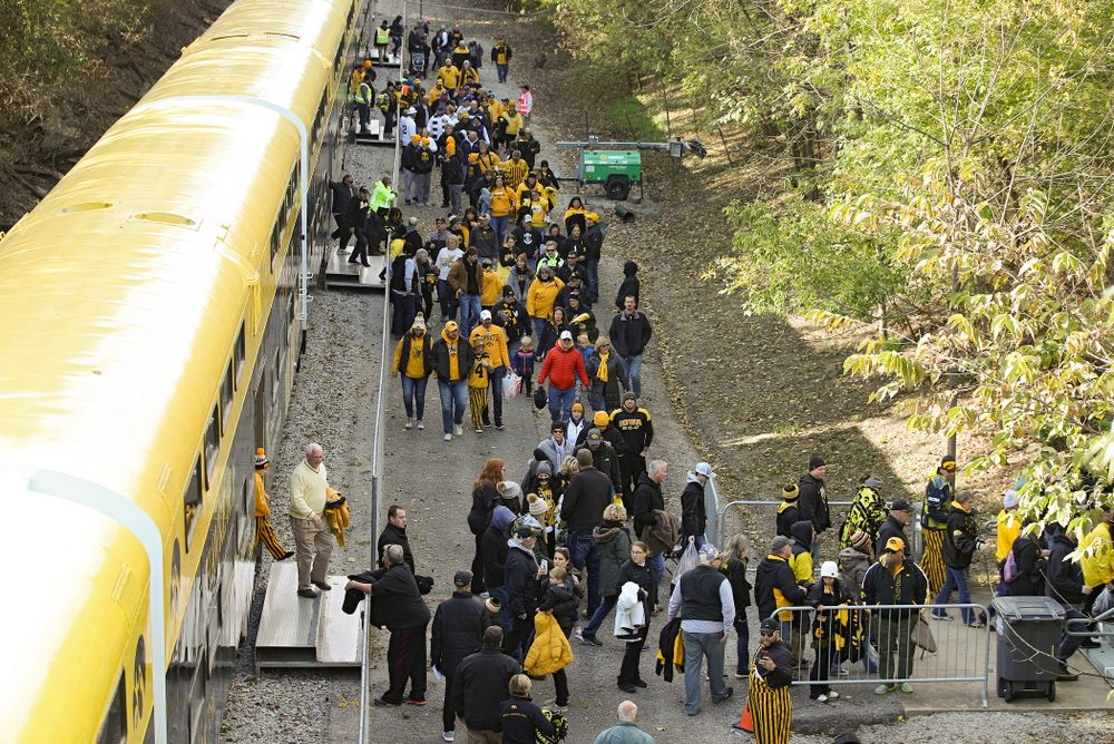 Fan make their way off the Hawkeye Express before the game at Kinnick Stadium in Iowa City on Saturday, Oct 12, 2019. (Stephen Mally/hawkeyesports.com)