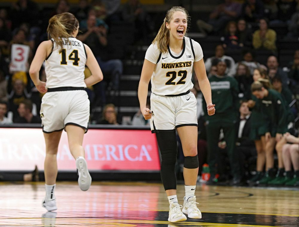 Iowa Hawkeyes guard Kathleen Doyle (22) is pumped up after guard Mckenna Warnock (14) made a 3-pointer during the fourth quarter of their game at Carver-Hawkeye Arena in Iowa City on Sunday, January 26, 2020. (Stephen Mally/hawkeyesports.com)