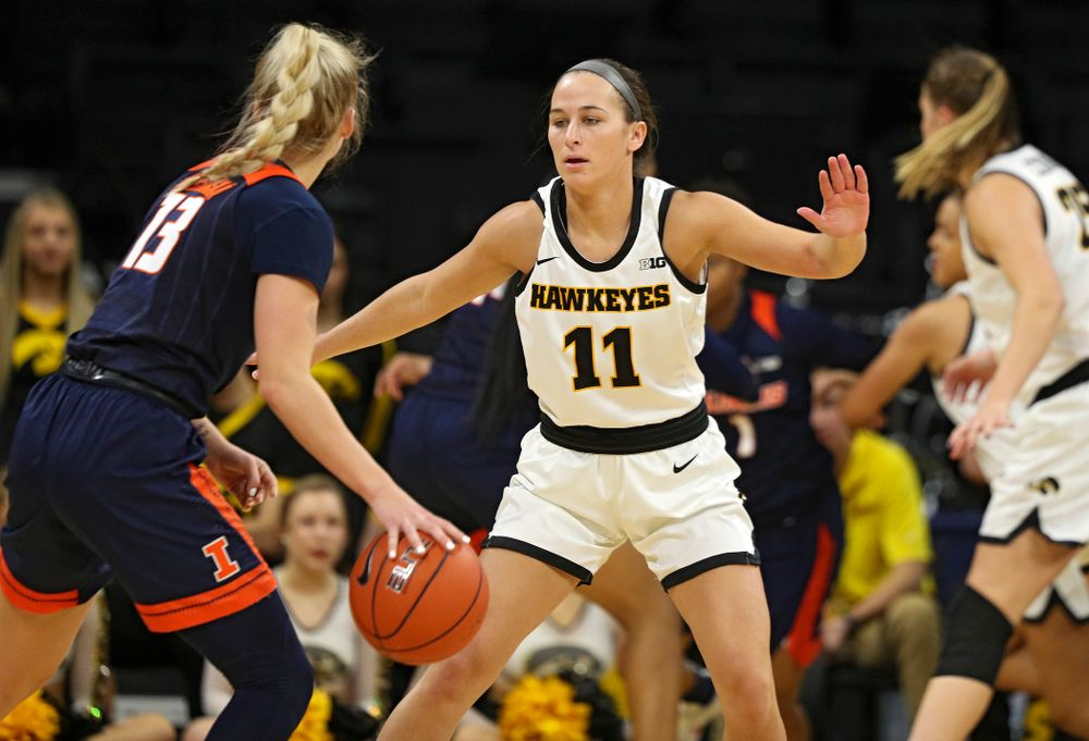 Iowa Hawkeyes guard Megan Meyer (11) defends during the fourth quarter of their game at Carver-Hawkeye Arena in Iowa City on Tuesday, December 31, 2019. (Stephen Mally/hawkeyesports.com)