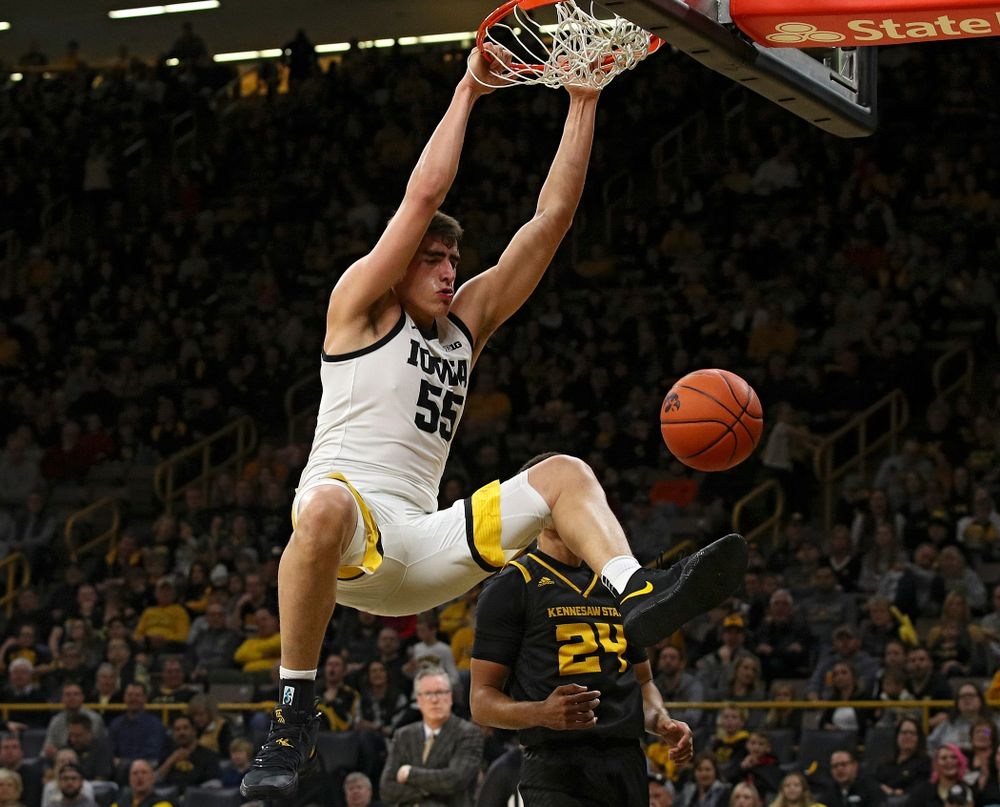 Iowa Hawkeyes center Luka Garza (55) dunks the ball during the second half of their their game at Carver-Hawkeye Arena in Iowa City on Sunday, December 29, 2019. (Stephen Mally/hawkeyesports.com)