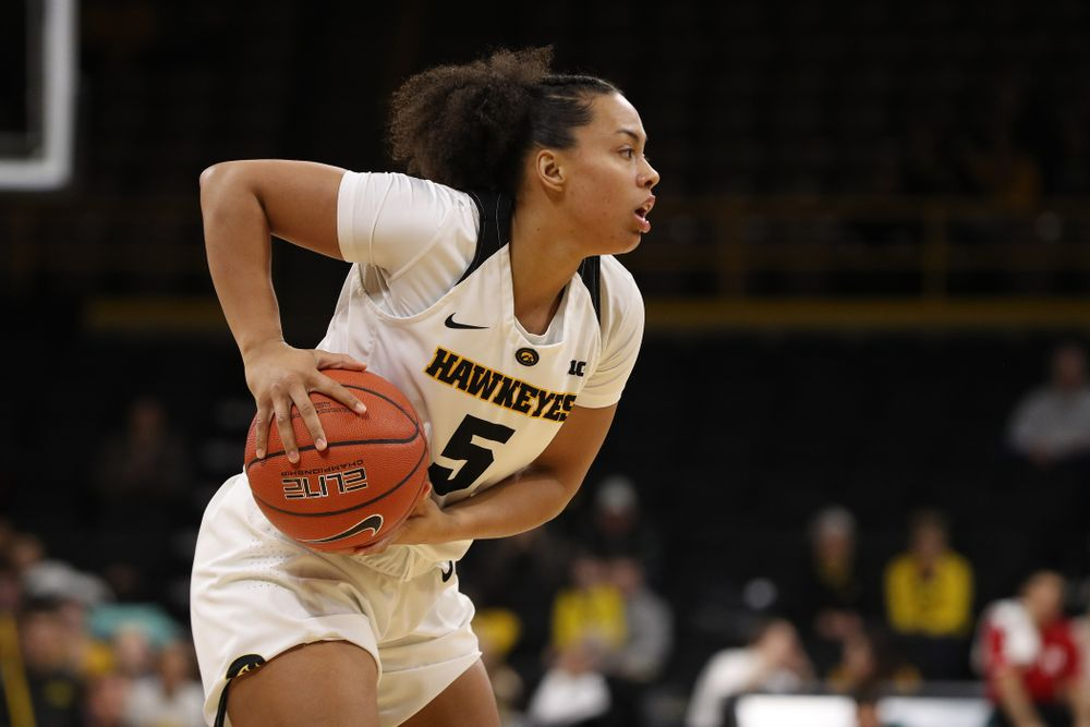 Iowa Hawkeyes guard Alexis Sevillian (5) against the Rutgers Scarlet Knights Wednesday, January 23, 2019 at Carver-Hawkeye Arena. (Brian Ray/hawkeyesports.com)