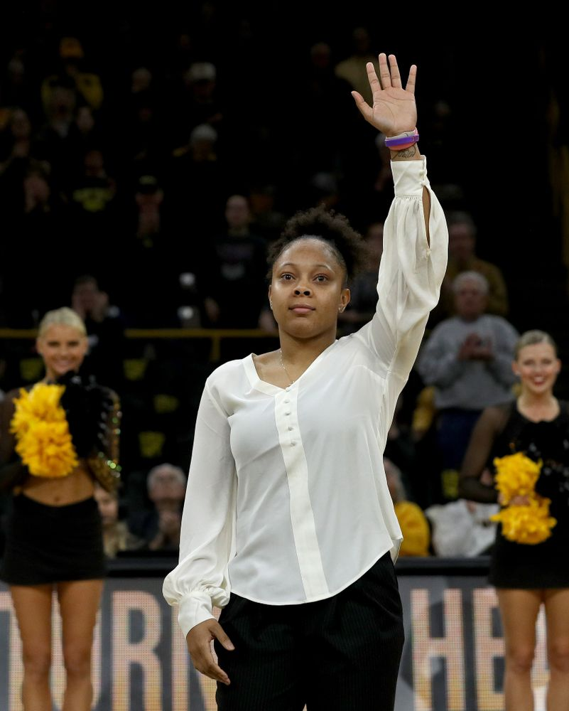 Former Hawkeye and Clemson graduate assistant Tania Davis waves to the fans after being introduced before their game Wednesday, December 4, 2019 at Carver-Hawkeye Arena. (Brian Ray/hawkeyesports.com)