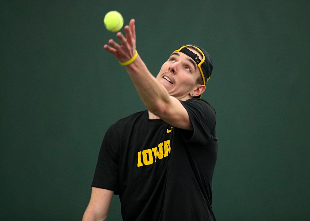 Iowa's Nikita Snezhko serves during his singles match at the Hawkeye Tennis and Recreation Complex in Iowa City on Friday, March 6, 2020. (Stephen Mally/hawkeyesports.com)