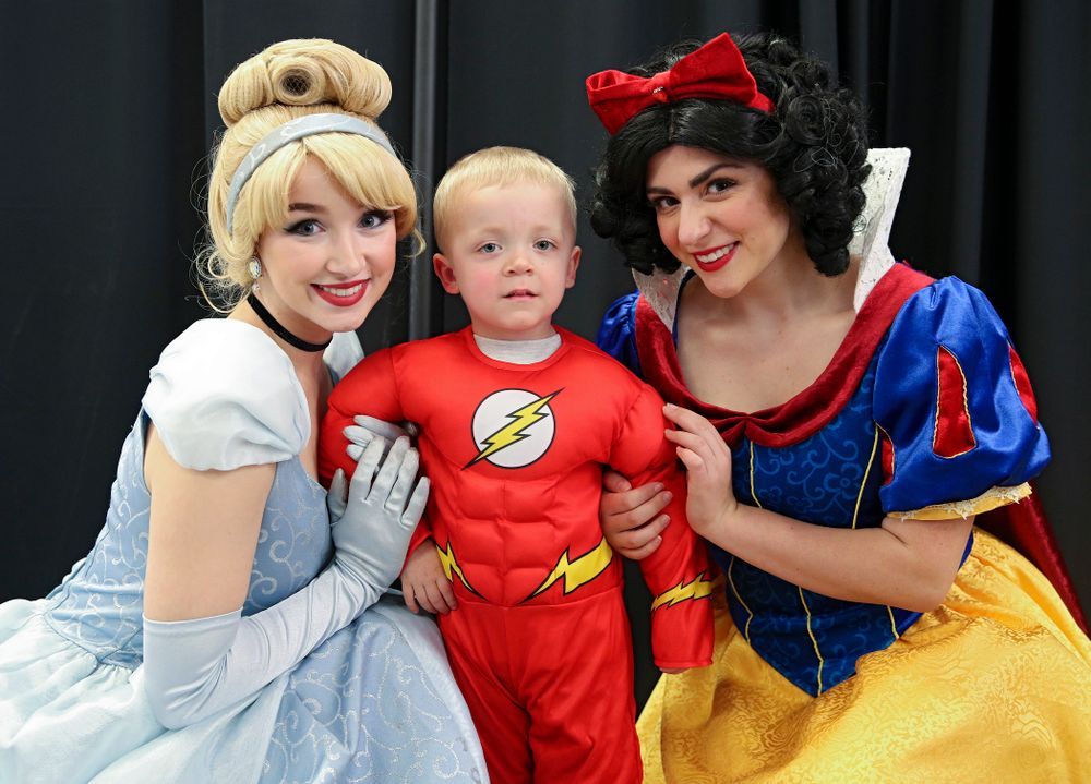 A young fan poses for a picture with two princesses on Superhero and Princess Day before the meet at Carver-Hawkeye Arena in Iowa City on Sunday, March 8, 2020. (Stephen Mally/hawkeyesports.com)