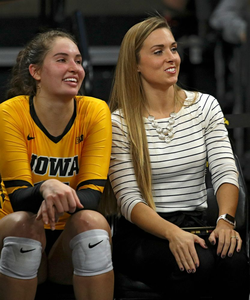 Iowa's Blythe Rients (11) and Emily Sparks, director of operations, sit on the bench during their match at Carver-Hawkeye Arena in Iowa City on Sunday, Oct 20, 2019. (Stephen Mally/hawkeyesports.com)