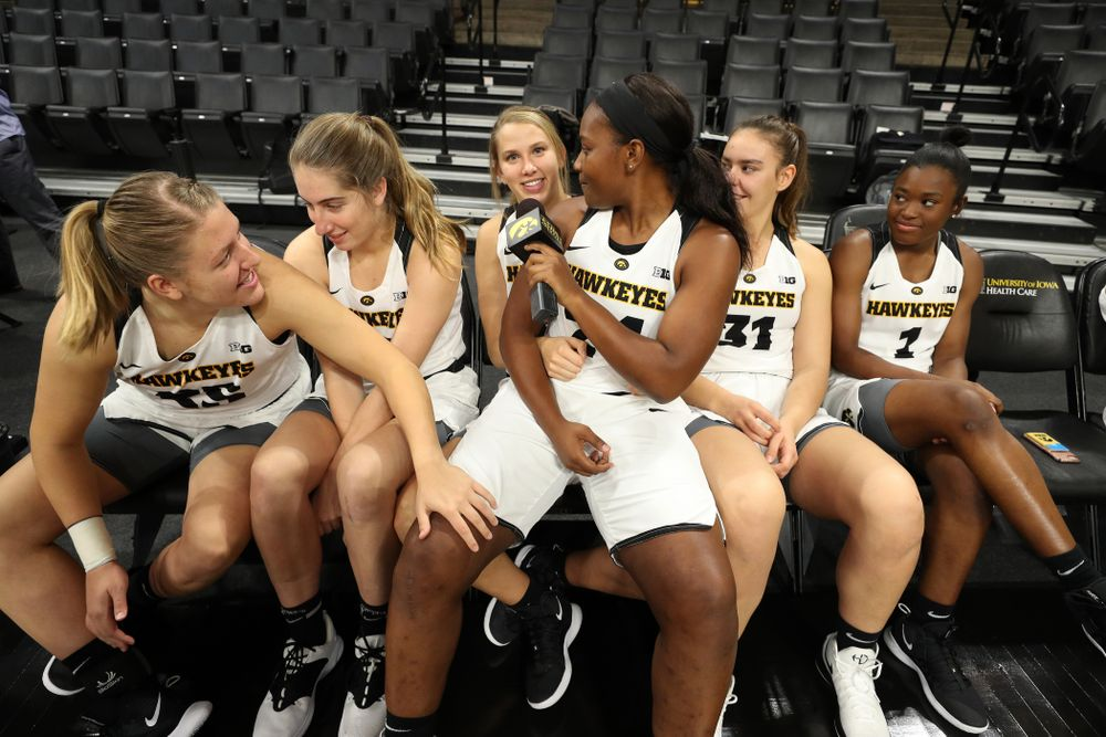 Iowa Hawkeyes guard Zion Sanders (24) interviews her teammates for a Facebook Live during the team's annual media day Wednesday, October 31, 2018 at Carver-Hawkeye Arena. (Brian Ray/hawkeyesports.com)