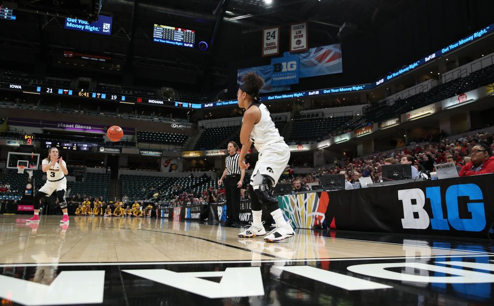 Iowa Hawkeyes guard Tania Davis (11) dishes off a pass to guard Makenzie Meyer (3) against the Indiana Hoosiers in the quarterfinals of the Big Ten Tournament Friday, March 8, 2019 at Bankers Life Fieldhouse in Indianapolis, Ind. (Brian Ray/hawkeyesports.com)