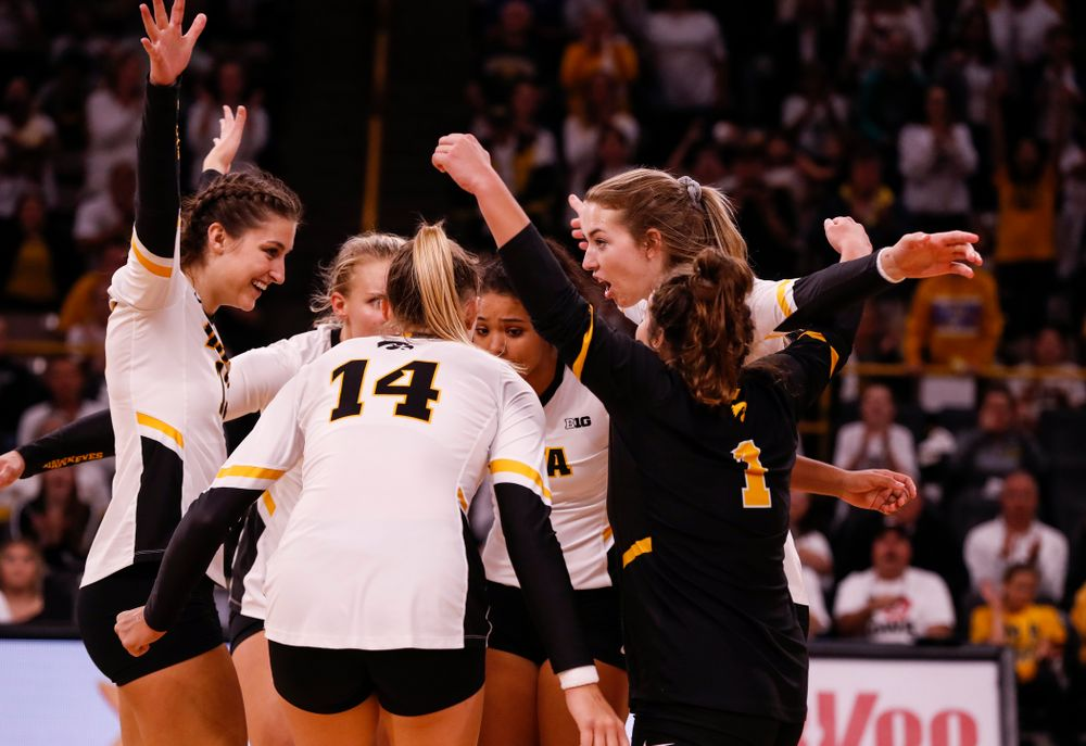 Iowa Hawkeyes middle blocker Sarah Wing (13) and outside hitter Meghan Buzzerio (5) against the Michigan State Spartans Friday, September 21, 2018 at Carver-Hawkeye Arena. (Brian Ray/hawkeyesports.com)