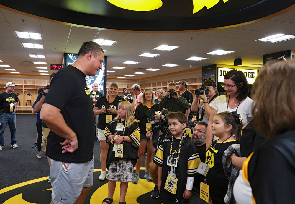Iowa Hawkeyes offensive coordinator Brian Ferentz talks with Kid Captains Kendra Hines and Jackson Tijerina during Kids Day at Kinnick Stadium in Iowa City on Saturday, Aug 10, 2019. (Stephen Mally/hawkeyesports.com)