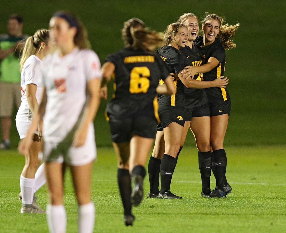 Iowa defender Sara Wheaton (24) celebrates her goal with defender Riley Whitaker (5) and defender Hannah Drkulec (17) as midfielder Isabella Blackman (6) comes running in during the first half of their match against Illinois at the Iowa Soccer Complex in Iowa City on Thursday, Sep 26, 2019. (Stephen Mally/hawkeyesports.com)