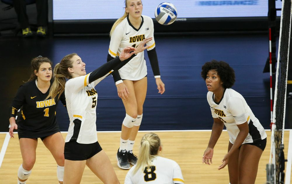 Iowa Hawkeyes outside hitter Meghan Buzzerio (5) sets the ball over the net during a game against Purdue at Carver-Hawkeye Arena on October 13, 2018. (Tork Mason/hawkeyesports.com)